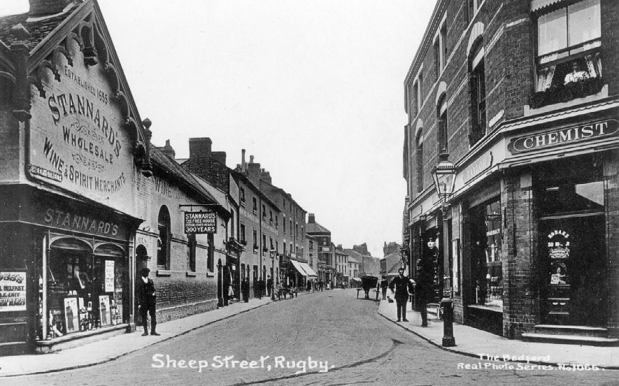 Stannard's wine and spirit merchants and Taylor's chemists shops in Sheep Street, Rugby.  1910s |  IMAGE LOCATION: (Warwickshire County Record Office)