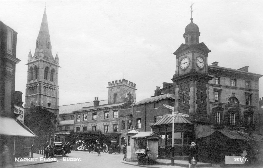 The Market Place, Rugby with the clocktower in the foreground.  Circa 1930 |  IMAGE LOCATION: (Warwickshire County Record Office) IMAGE DATE: (c.1930)