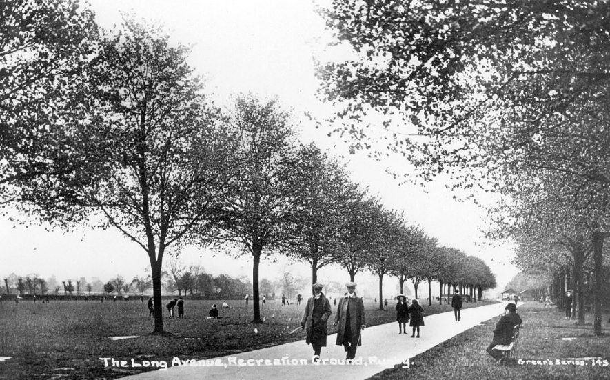 People strolling along The Long Avenue in the Recreation Ground, Rugby.  1910s    IMAGE LOCATION: (Warwickshire County Record Office)
