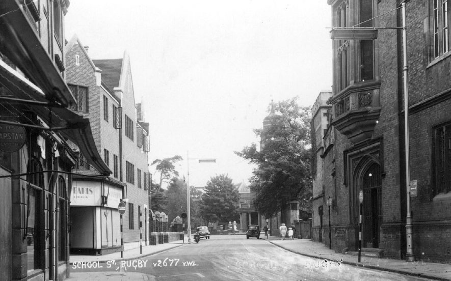 Lawrence Sheriff Street, Rugby showing part of Rugby School on the left. photo no.v2677.  1950s |  IMAGE LOCATION: (Warwickshire County Record Office)
