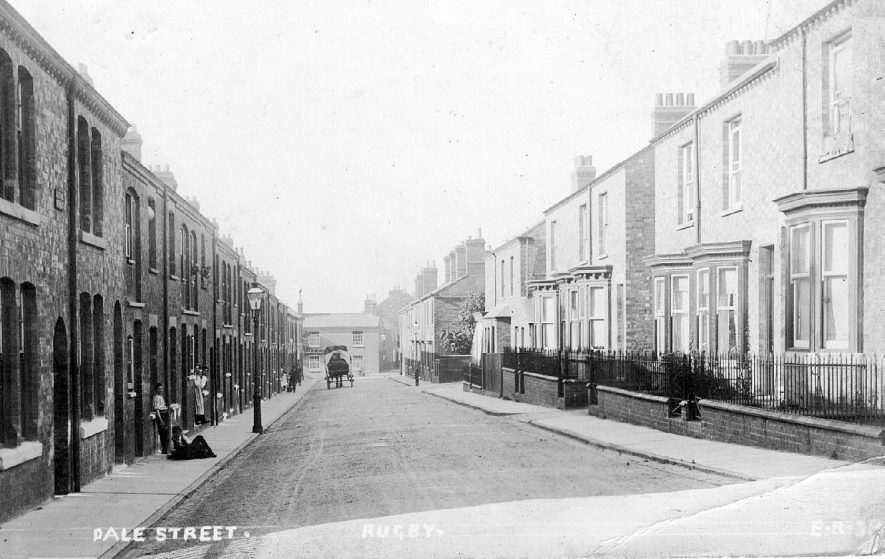 View looking down Dale Street with rows of terraced houses on either side and a few people in the street. original photo no. ER 38.  1900s |  IMAGE LOCATION: (Warwickshire County Record Office)