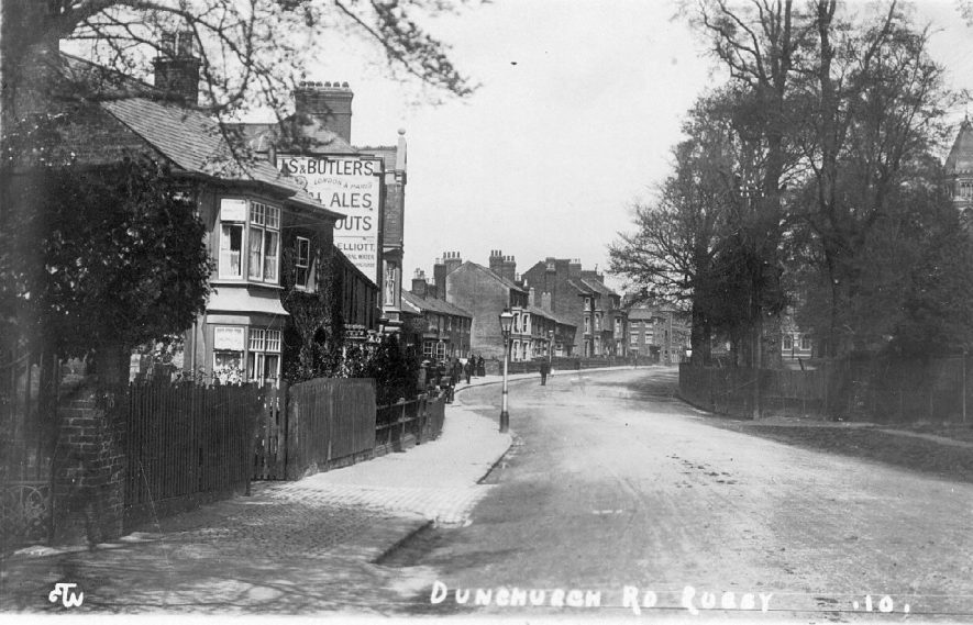 View of Dunchurch Road, Rugby showing an advertising sign for Mitchells & Butlers, ales and stouts. Original photo no. ETW 10.  1909 |  IMAGE LOCATION: (Warwickshire County Record Office)