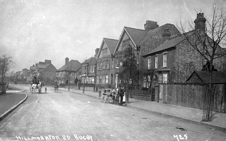 Street scene of Hillmorton Road, Rugby showing a row of large town houses and two horses and carts. 725.  1910 |  IMAGE LOCATION: (Warwickshire County Record Office)