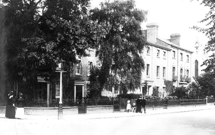 Russelsheim Way [Warwick Street], Rugby. Terraced houses and pedestrians.  1900s |  IMAGE LOCATION: (Warwickshire County Record Office)