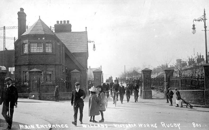 Entrance to Willans Victoria Works, Rugby.  Workers leaving.  1900s |  IMAGE LOCATION: (Warwickshire County Record Office)