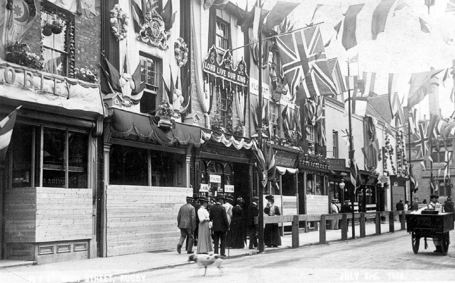 Rugby High Street decorated on occasion of visit of Edward VII.  1909 |  IMAGE LOCATION: (Warwickshire County Record Office)