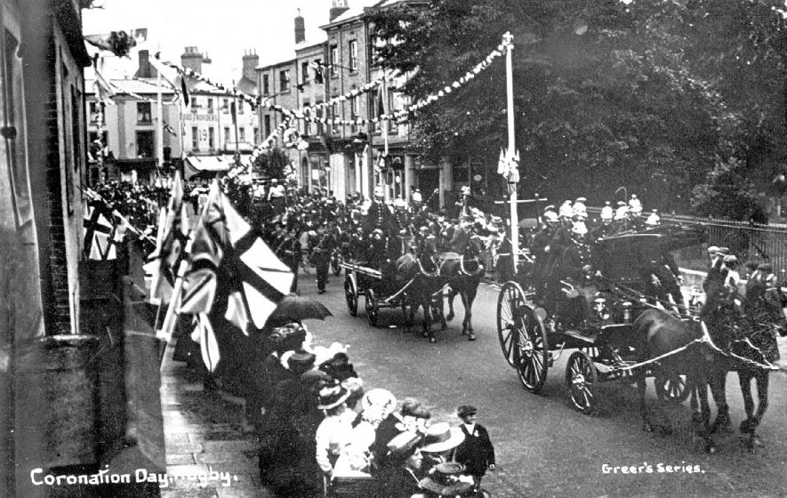 Parade of firemen in horse drawn vehicles on Coronation Day (King George V) in Rugby.  1911. |  IMAGE LOCATION: (Warwickshire County Record Office)