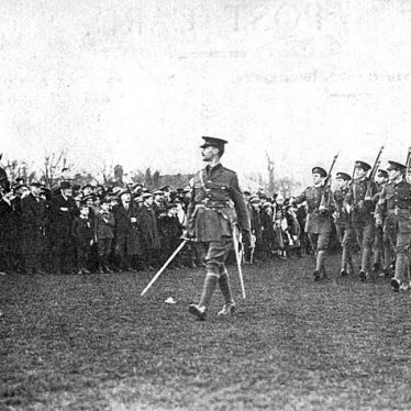 Rugby School O.T.C. saluting the flag at Rugby's celebration of The Armistice, 1918. [The Rugby School Officer Training Corps, led by its Band, headed the main procession through the town on November 12th. The procession started and finished at the Recreation Ground. The flag was saluted on the return to the Recreation Ground.] |  IMAGE LOCATION: (Warwickshire County Record Office)