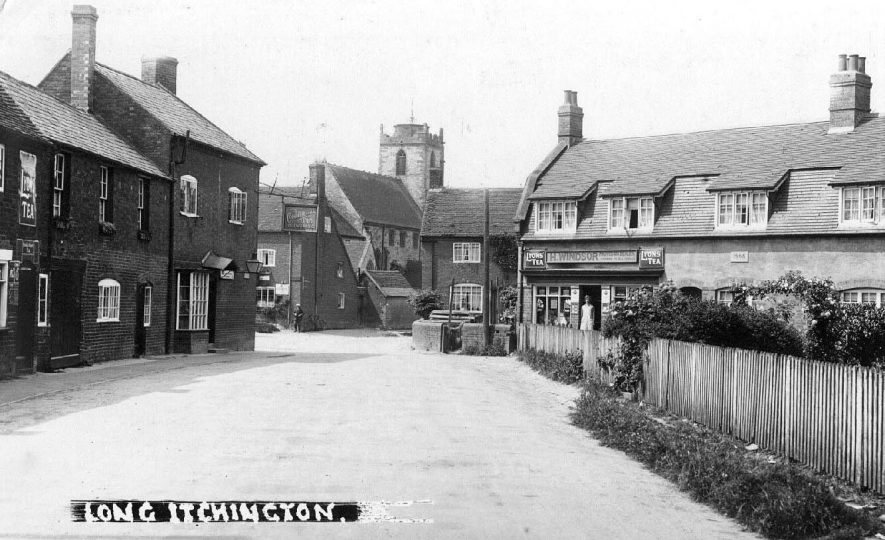 Church Road, looking west towards the church and Post Office; showing  the shop  of H. Windsor, provision dealer built c.1910 and The New Harvester Inn - previously The Commercial Inn. |  IMAGE LOCATION: (Warwickshire County Record Office)
