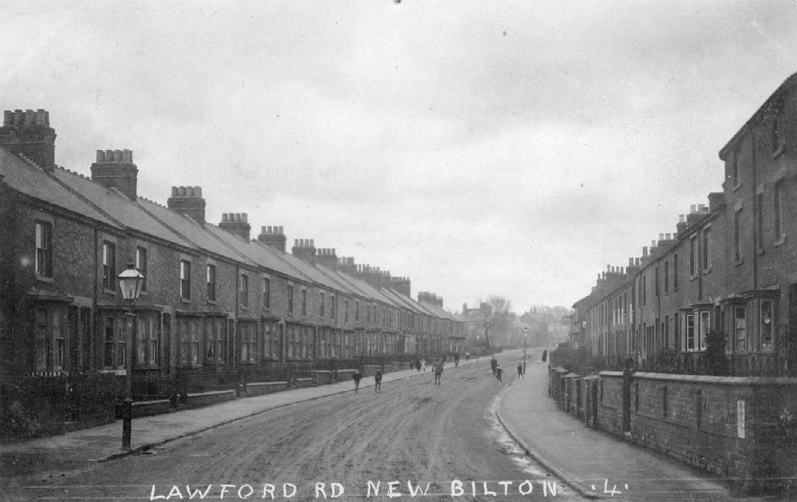 Terraced housing, with children in street on Lawford Road in New Bilton, Rugby.  1900s |  IMAGE LOCATION: (Warwickshire County Record Office)
