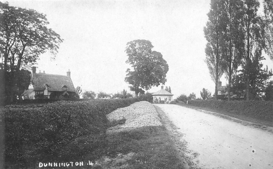 Road leading to lodge or gatehouse, Dunnington. Thatched and timber-framed cottage.  1900s |  IMAGE LOCATION: (Warwickshire County Record Office)