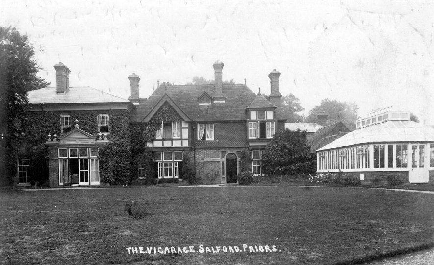 The Vicarage and its gardens, showing the French windows opening onto the lawn.  1910s |  IMAGE LOCATION: (Warwickshire County Record Office)