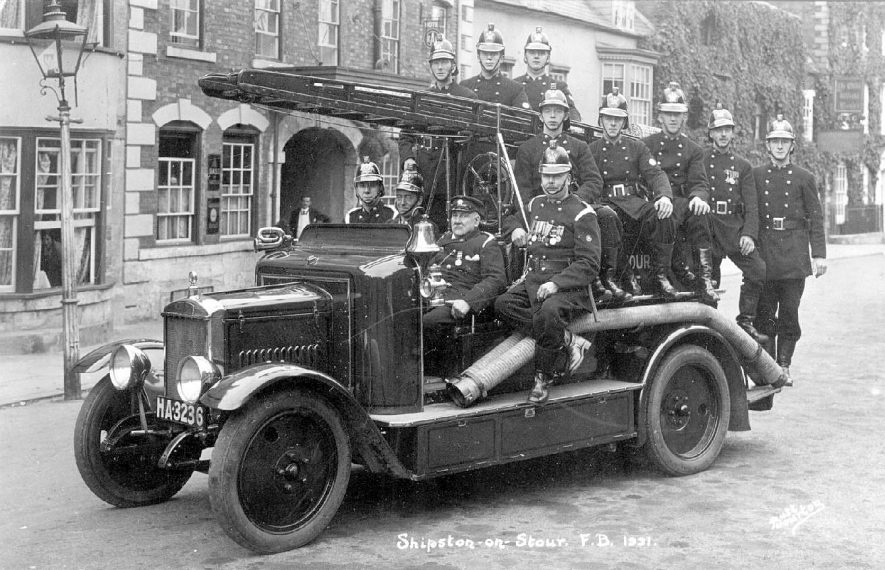 Shipston on Stour fire brigade on a motorised fire tender.  1931 |  IMAGE LOCATION: (Warwickshire County Record Office)