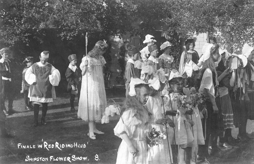 Shipston on Stour flower show. The finale of Red Riding Hood.  1900s |  IMAGE LOCATION: (Warwickshire County Record Office)