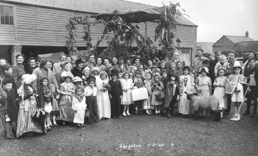 Group of children in fancy dress celebrating May Day in Shipston on Stour.  May 1st 1951 |  IMAGE LOCATION: (Warwickshire County Record Office)