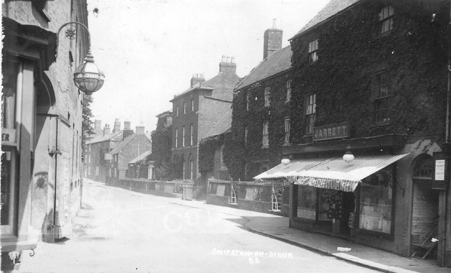 Church Street with Jarrett's clothier and drapery shop in the foreground.  1910s |  IMAGE LOCATION: (Warwickshire County Record Office)