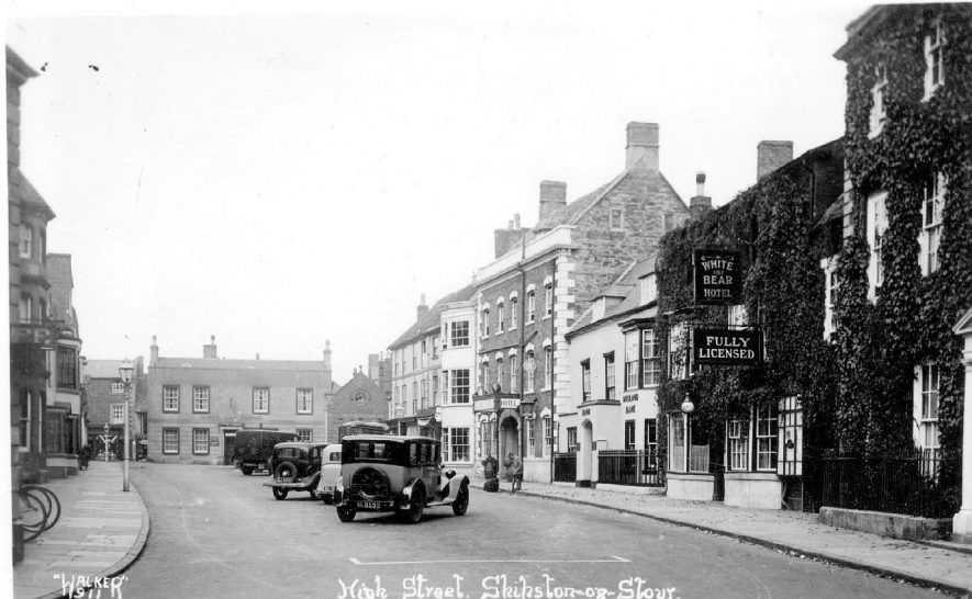 High Street with parked motor cars, Shipston on Stour.  The White Bear Hotel.  1930s |  IMAGE LOCATION: (Warwickshire County Record Office)