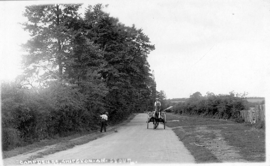 Campden Road, Shipston on Stour.  Man driving horse and wagon and another man sweeping road.  1930s |  IMAGE LOCATION: (Warwickshire County Record Office)