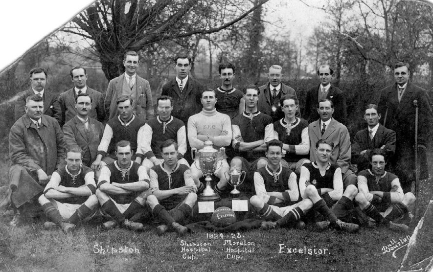 Shipston on Stour football team 1924-26 group photograph with the Shipston Hospital Cup and the Moreton Hospital Cup.  1926    IMAGE LOCATION: (Warwickshire County Record Office)