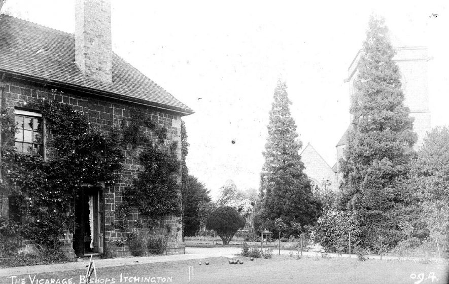 'The Vicarage, Bishops Itchington' [seen from the west, with St Michael's Church in the background]; croquet game on the Vicarage lawn.  1910s |  IMAGE LOCATION: (Warwickshire County Record Office)