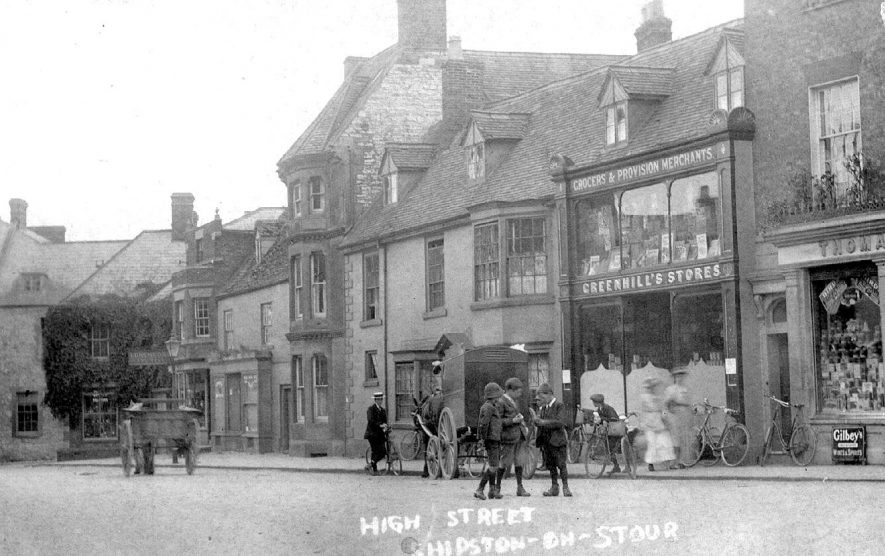 High Street with shops and horse-drawn vehicles, bicycles and pedestrians, Shipston on Stour.  1910s |  IMAGE LOCATION: (Warwickshire County Record Office)