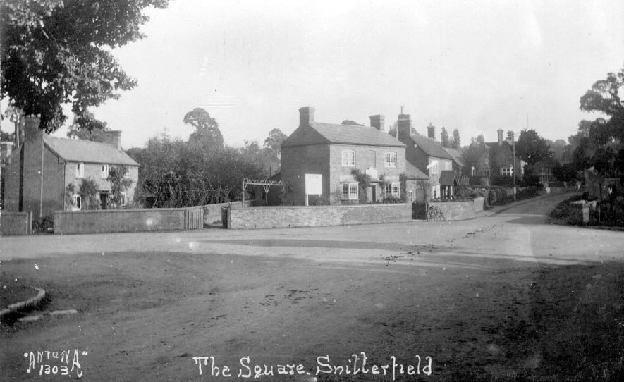 The Square, Snitterfield. The property in the centre of the photograph has a board above the front door which may indicate that it was a public house.  1920s |  IMAGE LOCATION: (Warwickshire County Record Office)