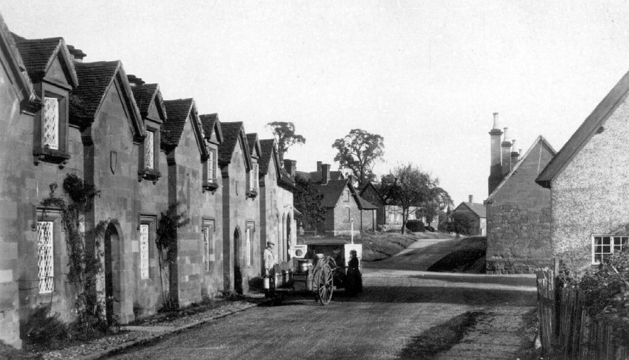 The Square, Stoneleigh.  Cottages, almshouses, milkcart with churns, milkman and customer.  1920s |  IMAGE LOCATION: (Warwickshire County Record Office)
