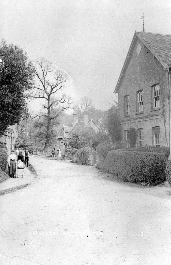 Church Lane, Stoneleigh, with pedestrians and baby in perambulator.  1910s |  IMAGE LOCATION: (Warwickshire County Record Office)