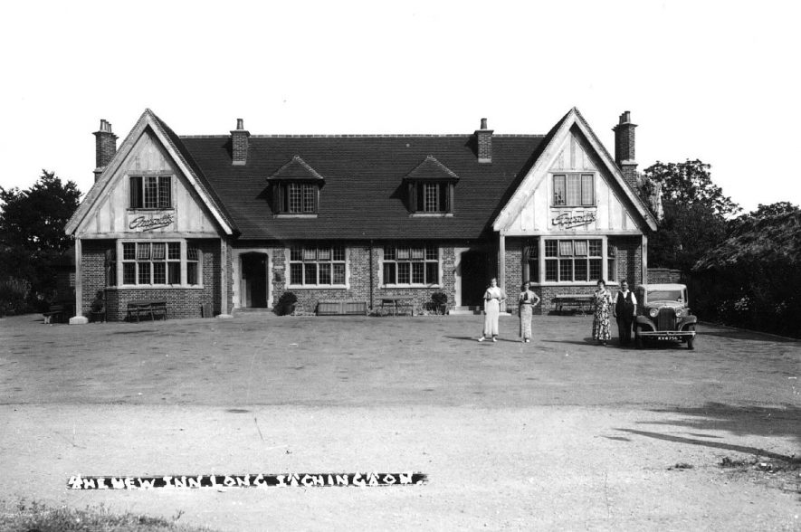 The New Inn, Long Itchington, - Ansells House showing an Austin  car, reg. number KV4756. Three women and a man standing. This is a rebuilding of the old New Inn which was on the same site but nearer the roadway.  1920s |  IMAGE LOCATION: (Warwickshire County Record Office)