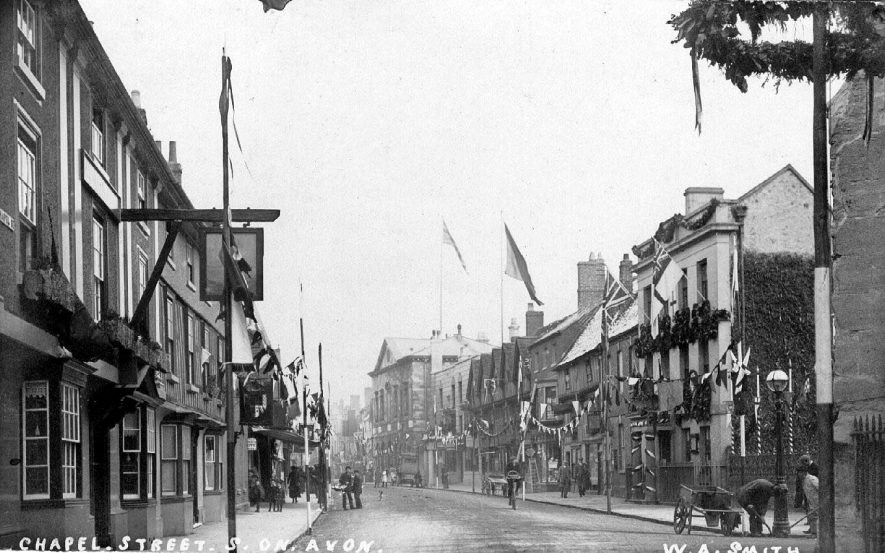 Chapel Street decorated for some occasion, Stratford upon Avon.  1910 |  IMAGE LOCATION: (Warwickshire County Record Office)