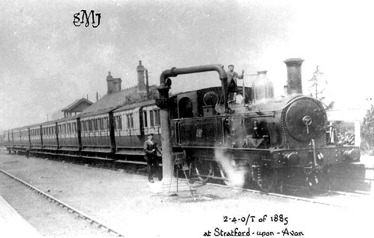 Passenger train in Stratford upon Avon station drawn by a 2.4.0/T of 1885, which is taking on water. 1900s[The correct location of this photograph is the A4390 Seven Sisters Meadow Road roundabout by Greenways car park and Old Town Mews, the site of the old Midland Junction Railway, The road is in fact built on the old trackbed] |  IMAGE LOCATION: (Warwickshire County Record Office)