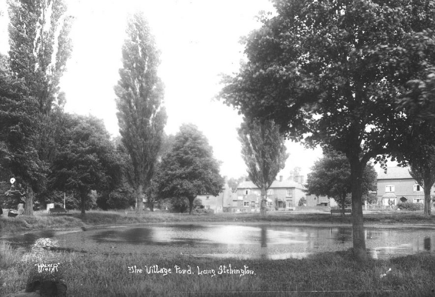 Long Itchington village pond showing surrounding houses.  1920s |  IMAGE LOCATION: (Warwickshire County Record Office)