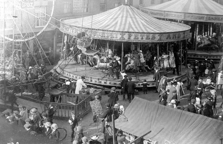 The mop at Stratford upon Avon showing fairground attractions.  circa 1910    IMAGE LOCATION: (Warwickshire County Record Office)