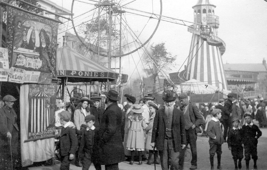 The mop showing fairground attractions, Stratford upon Avon.  circa 1910 |  IMAGE LOCATION: (Warwickshire County Record Office)