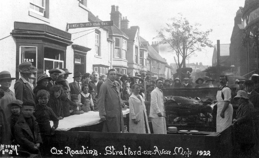 Ox roasting at the Stratford upon Avon mop.  1922 |  IMAGE LOCATION: (Warwickshire County Record Office)