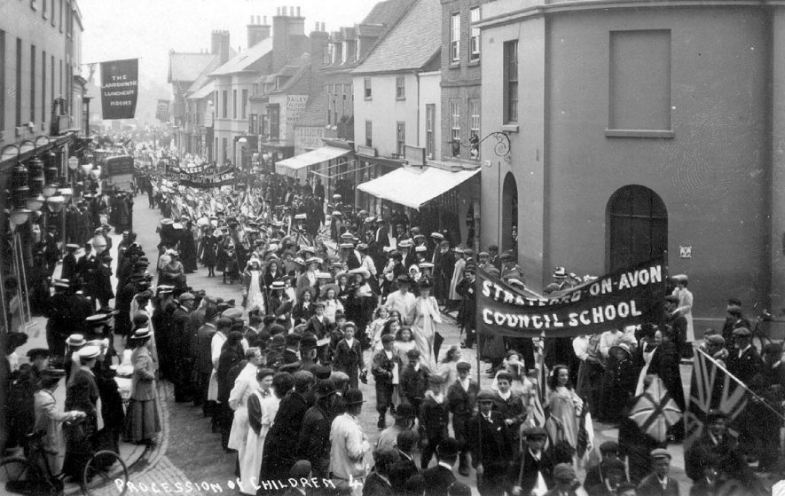 Procession of schoolchildren along Wood Street going to the Mayor's Treat, Stratford upon Avon.  1900s |  IMAGE LOCATION: (Warwickshire County Record Office)