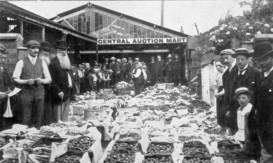 Stall, of Ribert Garrett, at the Stratford Central Auction Mart.  1910s |  IMAGE LOCATION: (Warwickshire County Record Office)