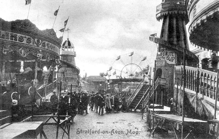 The Stratford upon Avon mop showing fairground attractions.  1910 |  IMAGE LOCATION: (Warwickshire County Record Office)