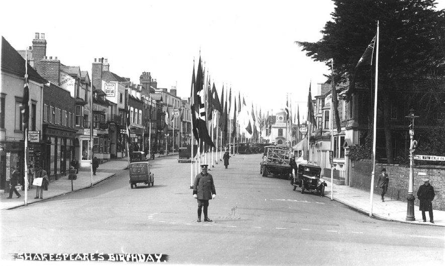Shakespeare's birthday, Stratford upon Avon.  Showing flags of all nations, the one in the foreground is said to be the German swastika.  1939 |  IMAGE LOCATION: (Warwickshire County Record Office)