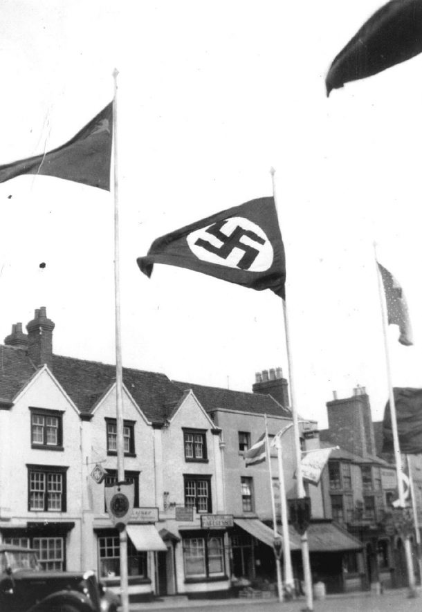 Shakespeare's birthday, Stratford upon Avon.  Hitler's swastika displayed in Bridge Street.  1939 |  IMAGE LOCATION: (Warwickshire County Record Office)