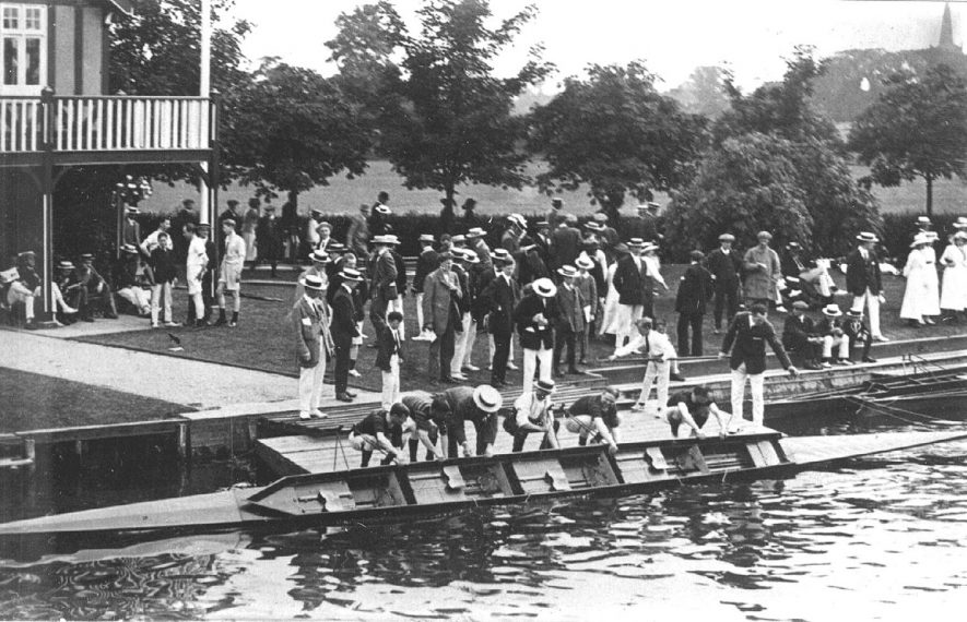 Stratford upon Avon regatta. Launching a sculling boat, a coxed four.  1900s |  IMAGE LOCATION: (Warwickshire County Record Office)