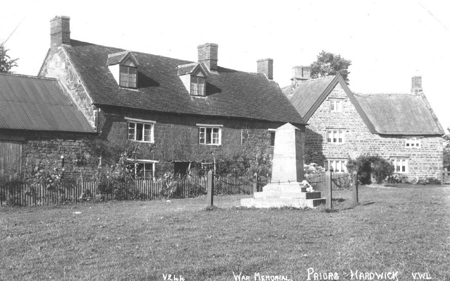 View of the War memorial and the houses behind it, Priors Hardwick.  1920s |  IMAGE LOCATION: (Warwickshire County Record Office)