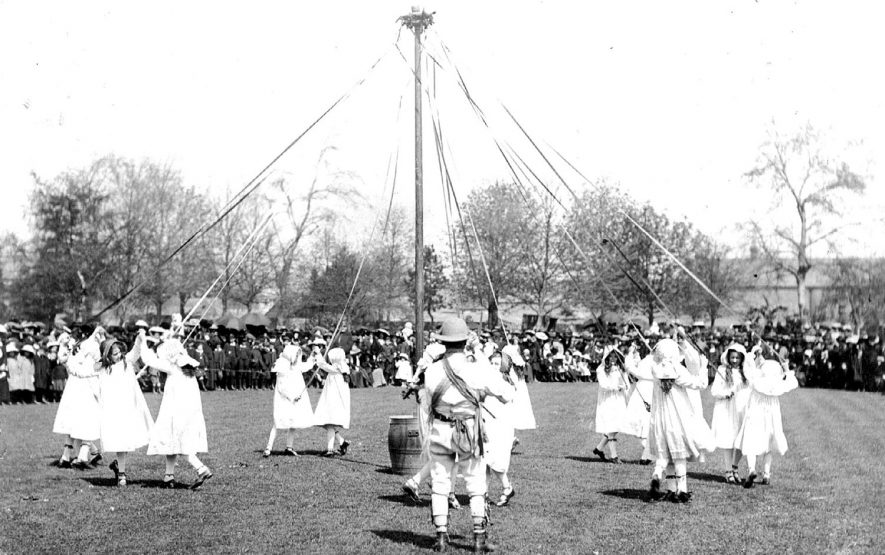 Children dancing round a maypole at Stratford upon Avon.  1910s |  IMAGE LOCATION: (Warwickshire County Record Office)