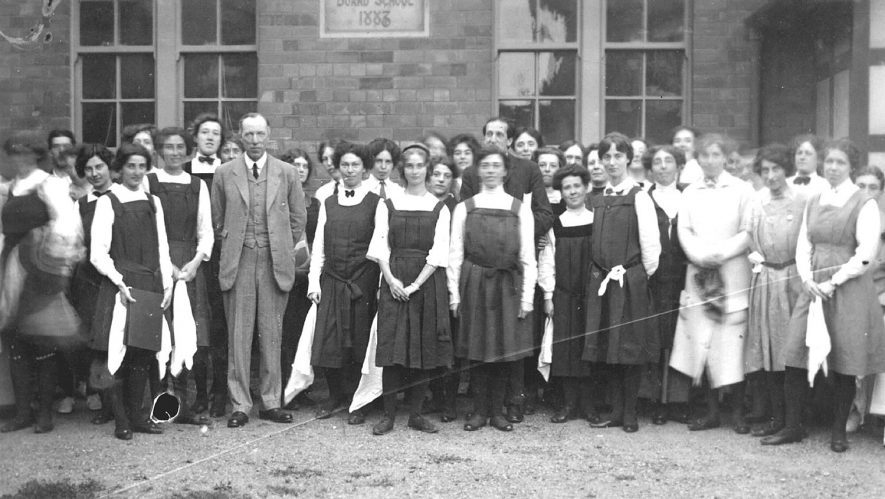 Group of schoolgirls and teachers outside The Board School, Broad Street, Stratford upon Avon.  1920s |  IMAGE LOCATION: (Warwickshire County Record Office)