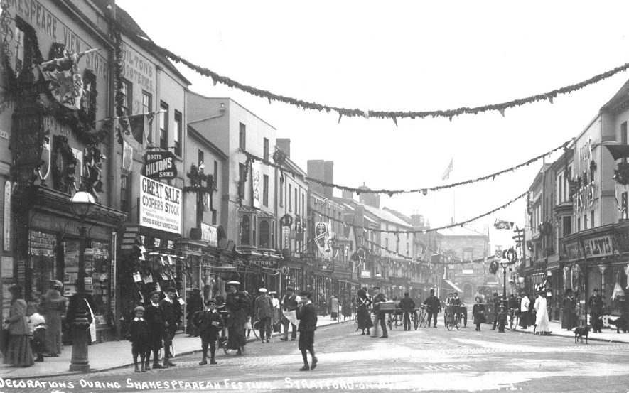 Decorations during Shakespearean Festival, High Street, Stratford upon Avon.  1907 |  IMAGE LOCATION: (Warwickshire County Record Office)
