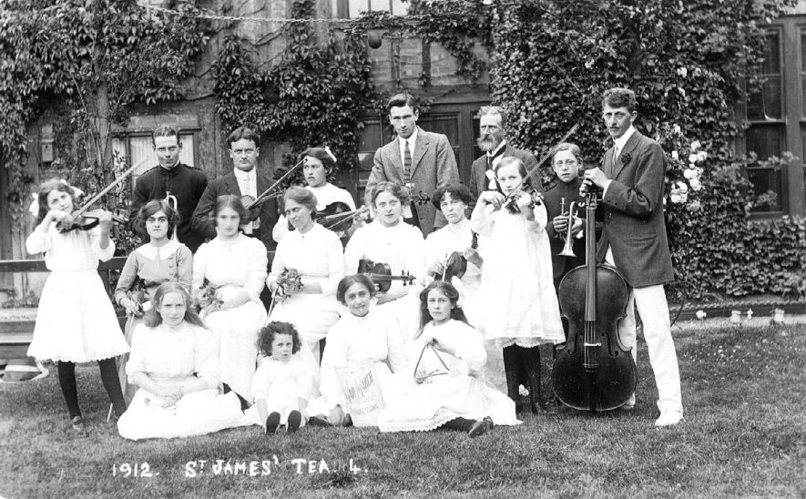 Group of men, women and children forming an orchestra at St James Church Tea, Stratford upon Avon.  1912 |  IMAGE LOCATION: (Warwickshire County Record Office)