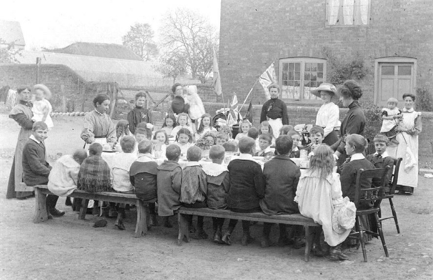 Children being fed at May Day celebrations, Long Itchington.  1912 |  IMAGE LOCATION: (Warwickshire County Record Office)