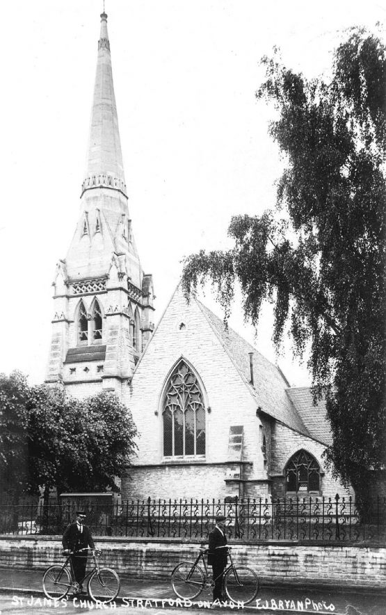St James the Great Church, Guild Street, Stratford upon Avon. Two men with bicycles in the road outside.  1900s |  IMAGE LOCATION: (Warwickshire County Record Office)