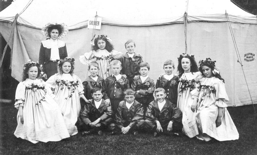 Shakespeare Festival Maypole Group, children posing in front of a tent at Stratford upon Avon.  1907 |  IMAGE LOCATION: (Warwickshire County Record Office)
