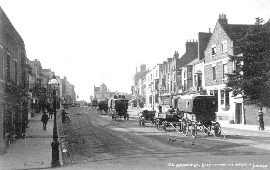 Row of carriages and carts in Bridge Street, Stratford upon Avon.  1900s |  IMAGE LOCATION: (Warwickshire County Record Office)